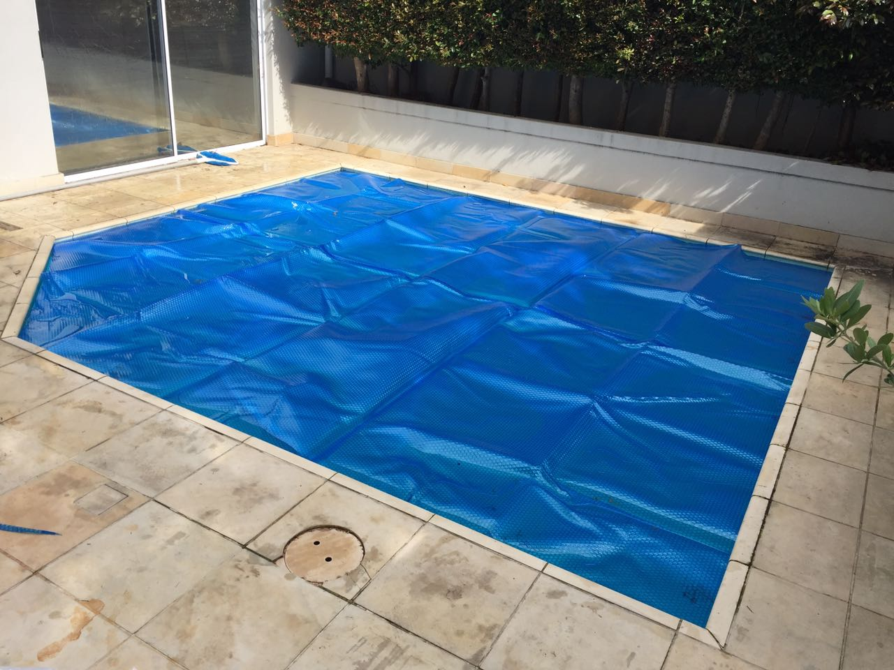 Pool covers flying out the door see today 39 s installation swimming pool covers cape town for Swimming pool covers south africa
